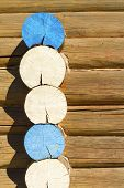 picture of log cabin  - Wooden log cabin wall colored in blue and white background - JPG