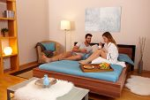 pic of bed breakfast  - Young couple having breakfast in bed in the morning - JPG