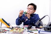 image of experiments  - Young student performs experiments in electronics and dreams of the future - JPG