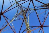 pic of mast  - Telecommunication mast with microwave link antennas over a blue sky - JPG