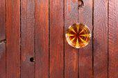 image of tumbler  - Tumbler glass full of whisky standing on a wooden table - JPG
