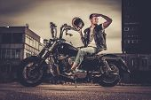 picture of carburetor  - Biker and his bobber style motorcycle on a city streets  - JPG