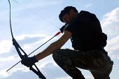 image of bow arrow  - The soldier shoots with bow and arrow - JPG