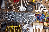 foto of triplets  - Assorted work tools on wood background - JPG