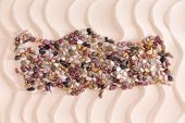 picture of agate  - Travel concept with a creative Turkish map formed of colorful water worn agate and quartzite pebbles on decorative golden beach sand with a rippling wavy pattern - JPG