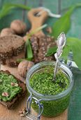 picture of pesto sauce  - Ramson, wild garlic and sauce pesto on a wooden table