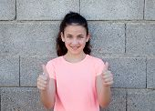 pic of  preteen girls  - Portrait of a beautiful preteen girl with blue eyes saying Ok - JPG