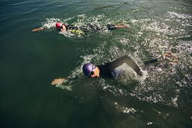 image of triathlon  - Competitors fighting in the swim event of a triathlon competition - JPG