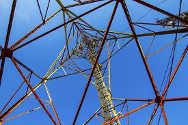 picture of antenna  - Telecommunication mast with microwave link antennas over a blue sky - JPG
