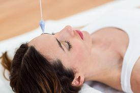 pic of hypnotic  - Woman being hypnotized while lying on the wooden floor - JPG