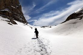 picture of plateau  - Silhouette of hiker on snow plateau - JPG