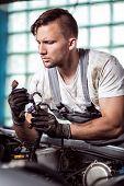 Постер, плакат: Automobile Repair Shop Worker
