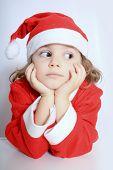 stock photo of gullible  - Portrait of little girl in Santa - JPG