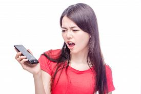 stock photo of frown  - Asian woman frowning unhappily at broken smart phone - JPG