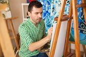 Постер, плакат: Handsome Artist Working On A Painting