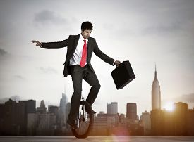 stock photo of adversity humor  - Businessman taking a risk in New York city - JPG