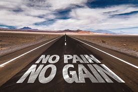 foto of transpiration  - No Pain No Gain written on desert road - JPG