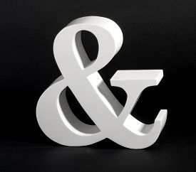 foto of ampersand  - Dimensional white Ampersand symbol on a black background a conjunctive character depicting the word  - JPG