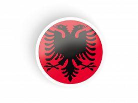 stock photo of albania  - Round sticker with flag of albania isolated on white - JPG
