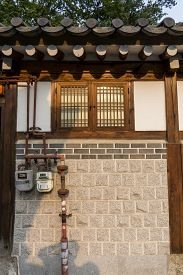 stock photo of dong  - Traditional korean house front gate with the sunset light - JPG