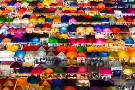 foto of roof-light  - Blurred bokeh lights of aerial view multiple colors flea market roof top - JPG