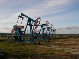 pic of raw materials  - Long line of oil pumping units on a large - JPG