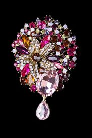 stock photo of brooch  - Colorful gem brooch brooch in the form of a flower on black background - JPG