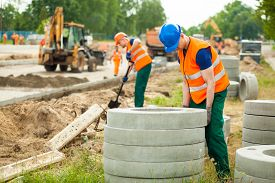 image of labourer  - Image of young labourer working hard on road construction - JPG