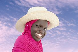 picture of ten years old  - Muslim girl wearing a straw hat at dawn - JPG