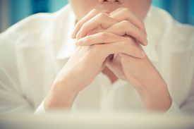picture of thinkers pose  - Close shot of a businessman being in contemplation on the foreground - JPG