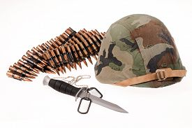 stock photo of cartridge  - Army helmet cartridges knife and badge on isolated background - JPG