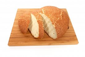 foto of fresh slice bread  - Fresh white bread sliced on a wooden chopping board - JPG