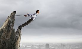picture of struggle  - Businessman struggling with problems that occur on the way - JPG