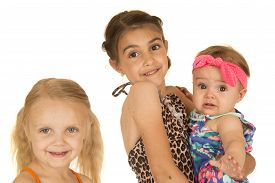 pic of three sisters  - Three beautiful caucasian sisters standing wearing swimsuits - JPG