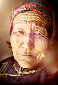 stock photo of mongolian  - Mongolian Woman Traditional Dress Tranquil Solitude Concept - JPG