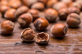 picture of filbert  - Hazelnuts filbert on old wooden background, studio shot