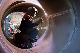 image of welding  - The welder weld root weld from inside of the housing of chemical apparatus - JPG