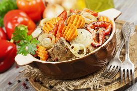 pic of liver fry  - Liver fried with paprika carrot and onion on the table - JPG