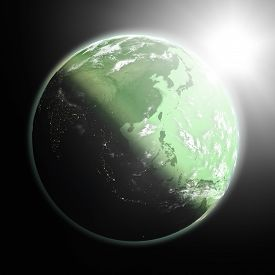foto of southeast  - Space view of the sun rising over southeast Asia on green planet Earth - JPG