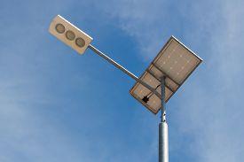 foto of light-pole  - Solar light pole on blue sky background - JPG