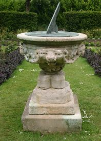stock photo of plinth  - Sundial on ornate plinth - JPG