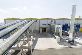 foto of combustion  - New modern industrial waste plant pipelines from the outside - JPG