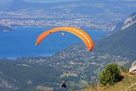 image of annecy  - paraglider flying above Lake Annecy in France - JPG