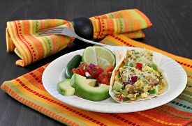 foto of jalapeno  - Mexican breakfast of a breakfast taco with eggs and chorizo - JPG