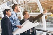 Engineer And Business Man Discuss About Blueprint poster