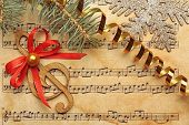 Beautiful composition with decorations on music sheet. Christmas songs concept poster