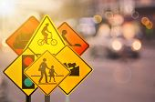 Set Of Traffic Warning Sign On Blur Traffic Road With Colorful Bokeh Light Abstract Background. poster