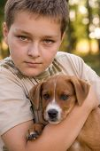 foto of 11 year old  - portrait of a boy with his pet - JPG