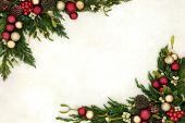 Christmas background border with gold and red bauble decorations, holly, mistletoe, ivy, juniper fir poster