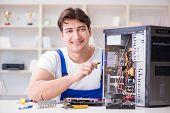 Computer repairman repairing desktop computer poster